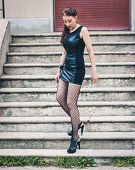 Pretty Goth Girl Posing In Urban Landscape