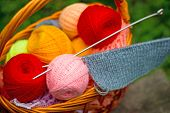 Basket Of Yarn And Knitting Needles