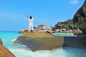 Middle-aged woman dressed in white doing yoga. Asana