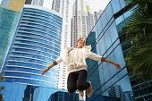 Latina Business Woman Jumping Joy Happy Office Smile