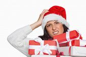 Shocked woman with christmas presents on white background