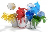 Four paint cans splashing different bright colors