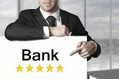 Businessman Pointing On Sign Bank Golden Rating Stars