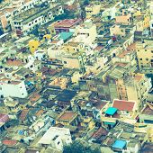 pic of trichy  - retro style image of colorful homes in crowded Indian city Trichy India Tamil Nadu - JPG