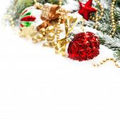 Christmas Decoration With Red Baubles Und Golden Gift Box