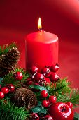 Christmas candles with festive decor