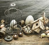 Vintage Easter Decoration With Eggs, Birdhouse And Birdcage