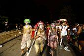 Painted revelers walking up Flatbush