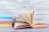 color books on grey wooden background