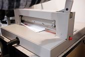 picture of guillotine  - Guillotine paper cutter on white background  - JPG