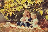 family in the autumn forest
