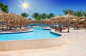HURGHADA, EGYPT - APR 29, 2012: tropical swimming pool at Hilton Long Beach Resort Hotel in Hurghada
