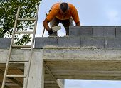 image of mason  - Mason performs an external masonry blocks concrete