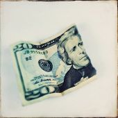 Instagram filtered image of a torn twenty dollar US bill 20