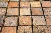Floor tile with brick