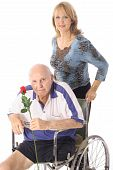 handicap elderly man with younger woman