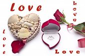 Red roses,love, an engagement ring and heart