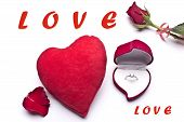 Red roses, love,an engagement ring and heart