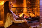 Girl Warming Up At Fireplace