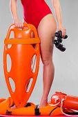 Lifeguard On Duty Holds Binocular