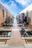 picture of public housing  - A bottoms up view of a Singapore public housing apartment where laundry is hung out to dry on bamboo poles from balconies - JPG