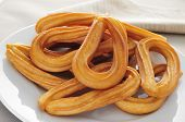 image of churros  - closeup of a plate with some churros typical of Spain - JPG