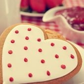 closeup of a heart-shaped biscuit on a set table for breakfast