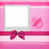 Photo frame and pink pacifier on polka dots background