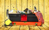 Toolbox with instruments one wooden background