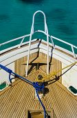 Ship deck with blue rope and yellow rope
