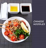 picture of chinese parsley  - Chinese noodles in bowl with vegetables on bamboo mat and space for your text - JPG