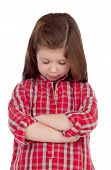 Sad little girl with red plaid shirt isolated on a white background