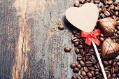 Coffee and chocolate  on grunge wooden background - Valentine's day and love concept
