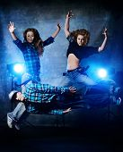 Group of modern dancers over grunge background. Urban, disco style.