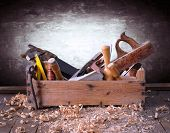 picture of carpentry  - Old toolbox on the workbench in a carpentry - JPG