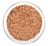 Brown Flax Seeds In Glass Bowl Isolated.