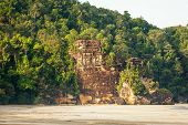 picture of cliffs  - Lush jungle and big cliff near sand beach bako national park sarawak borneo malaysia - JPG