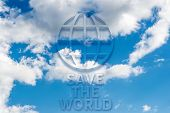 Save The World Message Written On  Blue Sky
