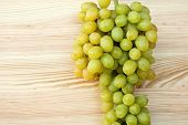 Bunch Of Ripe Grapes On A Wood Background