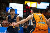 VALENCIA, SPAIN - JANUARY 24: Neto with ball and Nedovic during Spanish League match between Valencia Basket Club and UCAM Murcia at Fonteta Stadium on January 24, 2015 in Valencia, Spain
