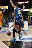VALENCIA, SPAIN - JANUARY 24: Neto 8 and Ribas during Spanish League match between Valencia Basket Club and UCAM Murcia at Fonteta Stadium on January 24, 2015 in Valencia, Spain
