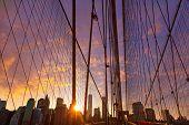 Brooklyn Bridge sunset with Manhattan skyline of New York City USA