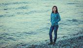 Young Woman Walking On Coast Near The Sea