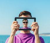 Man Doing Self-portrait With Digital Tablet