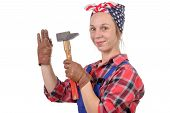 Young Woman Handyman Drive A Nail With A Hammer