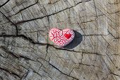 Red Speckled Heart On Wood