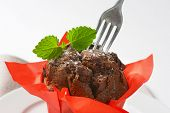 detail of smooth chocolate cupcake with fork