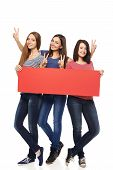 Three girl friends with red banner