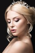 Beautiful blond girl in the image of a bride with a tiara in her hair. Beauty face. Wedding image.