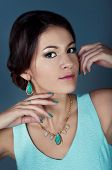 Studio Portrait Of Beautiful Brunette In Teal Dress